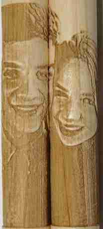 Close up image of photo-engraved drumstick set showing two people side by side