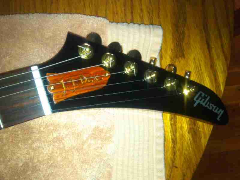 Custom gibson explorer trc with gold fill on cocobola wood