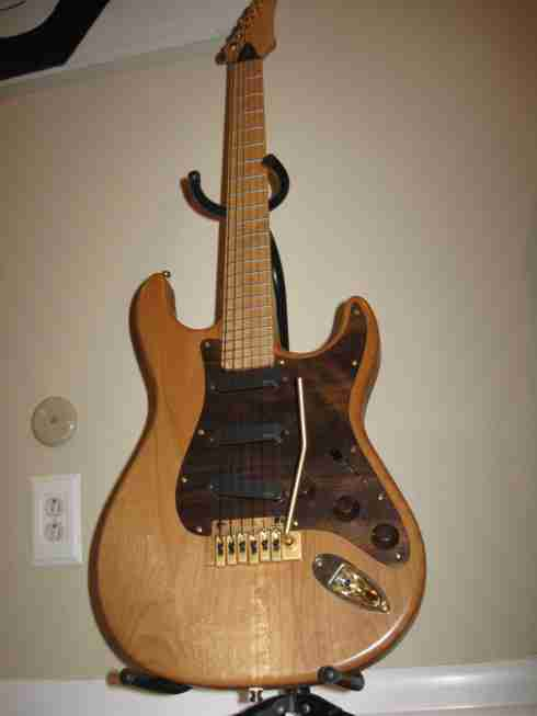 Peruvian walnut pickguard on Carvin with natural finish