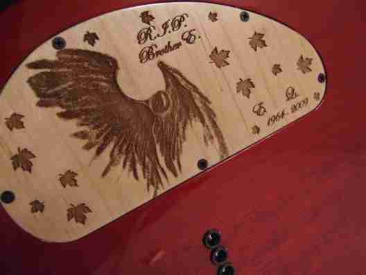 Angel graphic electronics cover done in maple on Musicman guitar